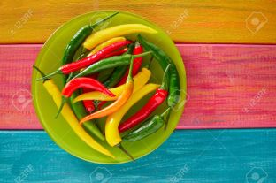 Colorful mexican chili peppers habanero red in wood table background